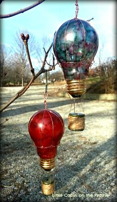 "I made upcycled hot air balloon ornaments as part of our gift baskets this Christmas but made extra for my sunny windows. These are burned out light bulbs, Ranger alcohol inks and the ""baskets"" are wooden spools covered with jute."