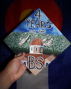 graduation cap cu boulder university of colorado business school leeds koelbel building flatirons