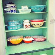 love the eclectic pyrex collection and turquoise shelves!