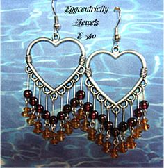 A glorious  fringe of 18-4mm A+ quality red Almandine garnets and 36- 4mm golden Hessonite garnets falls from the Bali silver hearts, all on sterling headpins and wires.They measure 2 inches from the top of the ear wires.