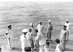 Sardar Vallabhbhai Patel being received at the Gateway of India on his return from the six-day visit to the United State of Travancore-Cochin on board INS Delhi in May 1950. Standing to the right of the Hon'ble Deputy PM is Commodore Inigo-Jones, Commodore-in-Charge Bombay, and greeting him is Mr. B.A. Dalal, Chairman of the Standing Committee of the Bombay Corporation.