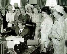 President Kennedy signs the 1963 Equal Pay Act into law.
