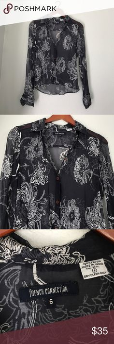 French Connection | Navy Button down w/ White Navy button down blouse with white floral design. brown buttons. Loose thred on 3rd button. Accepting offers! French Connection Tops Button Down Shirts