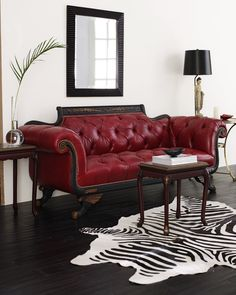 Old Hickory Tannery Red Tufted-Leather Sofa & Loveseat, Classic scrolled-arm sofa and loveseat in regal red leather feature carved accents and nailhead trim. Made in the USA of imported materials.