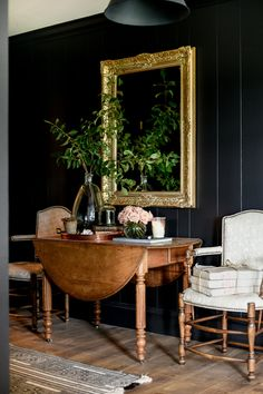 Black entryway with shiplap walls • antique furniture | boxwoodavenue.com