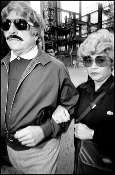 Photo by Bruce Gilden, New York City, 1984 'Couple in wigs' (please follow minkshmink on pinterest) #wigs #eccentric #newyork