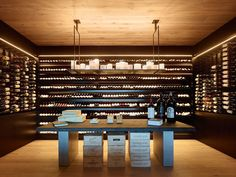 This modern house has a dedicated wine cellar with a table and plenty of storage. Circular Dining Table, A Table, Miami Beach, Whiskey Room, Whiskey Lounge, Yellow Accent Walls, Wood Handrail, Hidden Lighting, Small Hallways