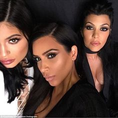 'Sneak peak!' Pregnant Kim Kardashian posted several dolled-up selfies alongside her sisters Kylie Jenner and Kourtney Kardashian from the set of their new E! promos on Friday