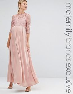 Maternity dress for a wedding. Blush colored dress with lace 3/4 sleeves