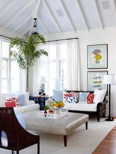Neutral colors for furniture and rug and add color with art and throw pillows.