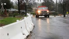 California storms:     The Los Angeles County Fire Department patrols Melcanyon Road, lined with K‐rails and other barriers in Duarte, Calif., in a threatened area below a San Gabriel Mountains burn area known as the Fish Fire, as a powerful storm moves into Southern California Friday, Feb. 17, 2017. The saturated state faces a new round of wet weather that could trigger flooding and debris flows.