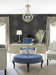 This lush home office features a Barbara Barry desk and Robert Allen ottoman. The charcoal wallpaper, creamy lacquered desk, blue velvet and silver silk all combine to bring glamour to a fashionable lady's home office.