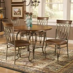 Hillsdale Montello 5-Piece Round Dining Set-Steel & Faux-Leather by Hillsdale. $810.01. Softly curving decorative motifs lend the Montello 5-Piece Round Dining Set - Steel & Faux-Leather a light and airy feel. These classic and casual pieces are the perfect choice for your dining room. Part of the Montello collection this set includes a round dining table top and base as well as a quartet of matching side chairs. Designed to seat four people comfortably the table measures 45 i...