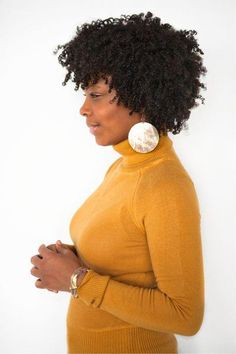Go to naturalhairsalonfinder.com and find a stylist for your natural hair.