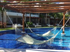One of our all-time favorites, Excellence Playa Mujeres never ceases to please. Imagine relaxing in a hammock over the lagoon style pool as a waiter brings over an ice cold drink...