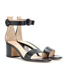 Gianvito Rossi - Leather sandals - These Gianvito Rossi sandals are a super-chic pair for everyday wear, laced with just the right balance of minimalism and feminine flair. Classic black leather is fastened at the ankle, while the modest heel is comfortable while adding height to your look. seen @ www.mytheresa.com