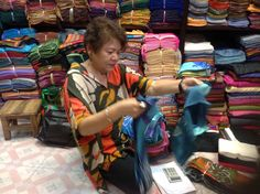 Selecting silk scarves and shawls.  What a feast of colors!  #charlottesville #boutique