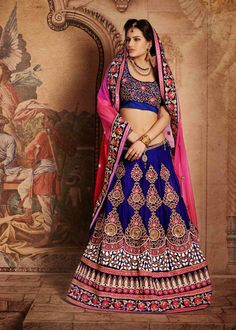 #Pink and #blue net and #velvet #lehenga style #saree fabricated with zari, #resham embroidery, stone, #sequins, beads and patch border work with embroidery work on border, blouse and double layered.