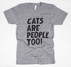 This lovely illustrated shirt by Will Bryant features an assortment of cats stretching, sitting, copping attitude, as cats do, all over some big bold letters.