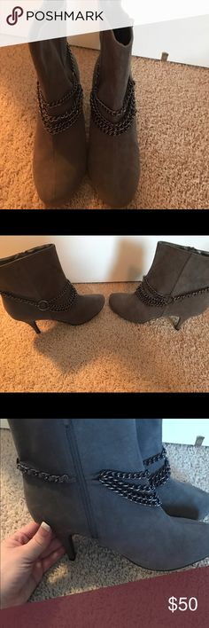 Gray suede heel ankle boots Suede, Heel gray ankle boots, with chains on each one, never been worn even though I do not have the box. So cute! Definitely a statement piece. classique Shoes Heeled Boots
