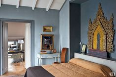 In the master bedroom of architect and designer Dmitry Velikovsky's home in Moscow, the master bedroom is anchored by an ornate piece atop the headboard that was originally the back of a Burmese monk's chair. Next Bedroom, Blue Bedroom, Master Bedroom, Guest Bedrooms, Exotic Bedrooms, Beautiful Bedrooms, Eclectic Bedrooms, Architectural Digest, Ikea