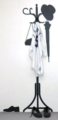Very clever... 2D coat rack silhouette (Coat Hanger & Decal Set)... In the absence of a mud-room, I need this for behind my front door!
