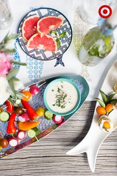 When serving guests, Target Home Style Expert, Emily Henderson, likes to design a palette using bright foods mixed with neutral serveware to create a visually enticing spread.