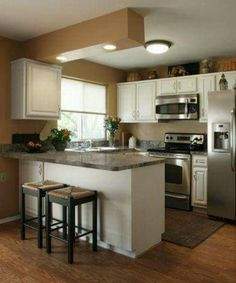 There is no question that designing a new kitchen layout for a large kitchen is much easier than for a small kitchen. A large kitchen provides a designer with adequate space to incorporate many convenient kitchen accessories such as wall ovens, raised. Kitchen Redo, New Kitchen, Kitchen Dining, Kitchen Island, Kitchen Stools, Kitchen White, Bar Stools, Kitchen Cabinets, Kitchen Magic