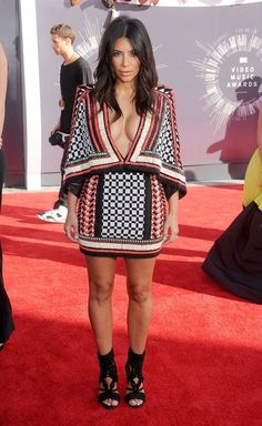 Kim Kardashian in Balmain dress and shoes.