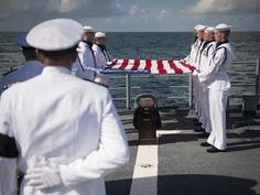 """Members of the US Navy ceremonial guard hold an American flag over the cremains of Apollo 11 astronaut Neil Armstrong during a burial at sea service aboard the USS Philippine Sea"" - NASA Apollo 11 Mission, Apollo Missions, Neil Armstrong, We Are The Mighty, Moving Photos, Apollo Program, One Small Step, Sea Photo, Man On The Moon"
