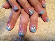 Baby blue nails with bling