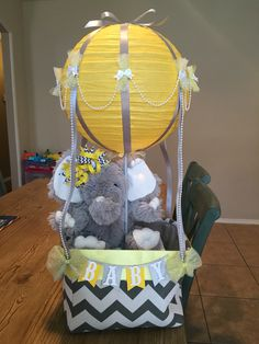 Gender neutral Baby shower hot air balloon. Yellow grey baby shower. Elephant themed. Diapers in the basket.