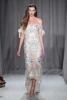 Bring silver, holiday cheer to a winter wedding.Dress available at Catherine Deane.