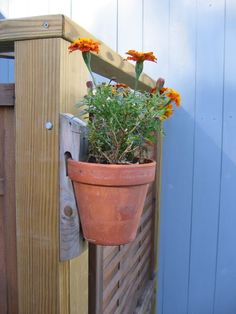 Flower Pot Holder. Hangs anywhere: porch, post, wall or along fence.