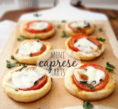 caprese tarts made with tomato, balsamic, basil, and mozzarella. all on a bed of puff pastry.