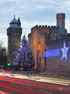 Cardiff Castle with Christmas Lights and Traffic Light Trails, Cardiff, South Wales, Wales, United  Photographic Print