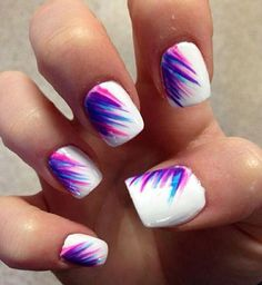 Cool looking feather nail art design that is perfect for your summer escapades with friends. Backed with a plain white polish, your nails are then painted with a combination of blue, pink and violet hues. Simple but looks amazing! #nailart