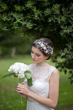 Hermione Harbutt May Blossom Headdress.  Pearl flowers with branching pearl and Swarovski crystal tendrils, sweep around the head in this stunning statement piece. Image by Catherine Mead. #woodland #wedding #inspiration