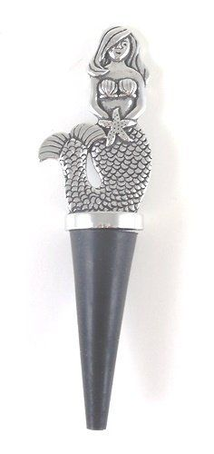 Pewter Nautical Mermaid Wine Bottle Topper by Basic Spirit. $21.88. Fits standard wine or cider bottles. Measures 5 inches x 1 1/4 inches x 1 inch. Made of hand crafted Pewter - lead free. Tropical Nautical Mermaid Wine Bottle Topper. Save 27% Off!