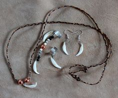 Gray fox tooth jewelry by Lupa. Available at http://thegreenwolf.etsy.com