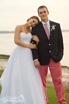 Me and my hubby Gambol Photography vineyard vines bride and groom wedding attire. Preppy, Southern, Fratty, Dapper, Colleton River Plantation. Bluffton, South Carolina. Vineyard Vines Wedding.Coral Pants Navy Blazer Starfish Boutonniere, Sperrys