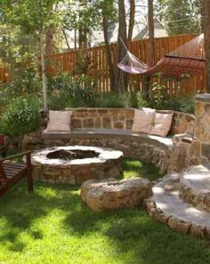 Stone wall / bench and fire pit. No grass around it though. Stone patio.