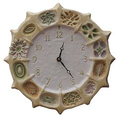 Wheel of Life Ceramic Wall Clock in Cream & White by Beth Sherman: Ceramic Clock available at www.artfulhome.com