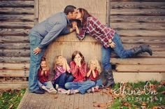 Ew! Mom and dad are kissing! This is a cute pose with kids giggling at their parents being affectionate!