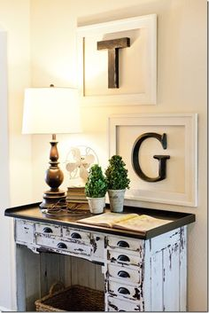 Feature Friday: Little Cottage on the Pond. Add letter initials in the master bedroom gallery wall