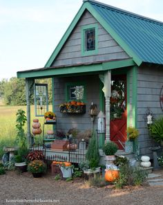 Love the fence on the front!!! AND the stained glass hanging!!  Cute place to sit and enjoy your labors!