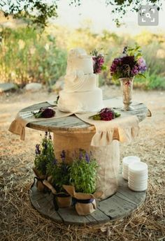 *WEDDING CAKE TABLE* Wood spool painted white with 'The Blankenships Est. 2017'