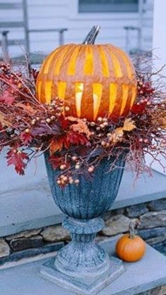 I love the way this pumpkin is carved!  Just a stunning idea all the way around for a pretty Fall look on your front porch.  My goodness, I LOVE Fall decor!  The post Gorgeous Pumpkin Fall Porch Decor Idea appeared first on Pinteresting Finds.  #SoPinteresting #HomeDecor http://pinteresting.involvery.com/gorgeous-pumpkin-fall-porch-decor-idea/
