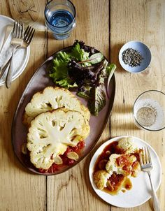 Whole pot-roasted cauliflower with tomatoes and anchovies