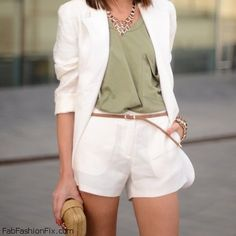 Elegant summer look with white blazer and white shorts